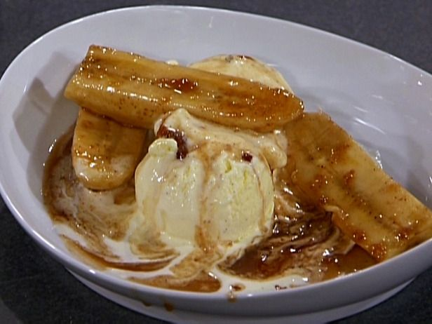 Bananas Foster Ingredients 1/4 c butter 1 c brown sugar 1/2 t cinnamon 1/4 c banana liqueur 4 bananas, cut in 1/2 lengthwise, then horizontal 1/4 c dark rum 4 scoops vanilla ice cream Directions Combine butter, sugar, & cinnamon in a skillet. Place pan on low heat stirring until sugar dissolves. Stir in banana liqueur & place bananas in pan. When bananas soften add rum. Tip the pan to ignite rum. (A lighter works too) Place 4 pieces over ea scoop of ice cream & spoon sauce over top serve…