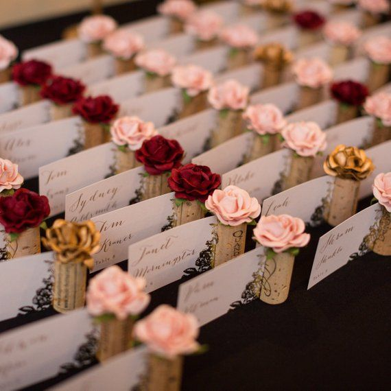 Photo of Blush pink wedding place card holder. Wine tasting bridal shower decorations. Unique rustic vineyard wedding decor. Wine theme wedding