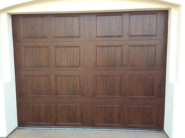 Clopay Gallery Garage Door Dark Finish Will Have Rectangular Windows At Top And Iron Decorative Hardware On It Garage Doors Doors Garage
