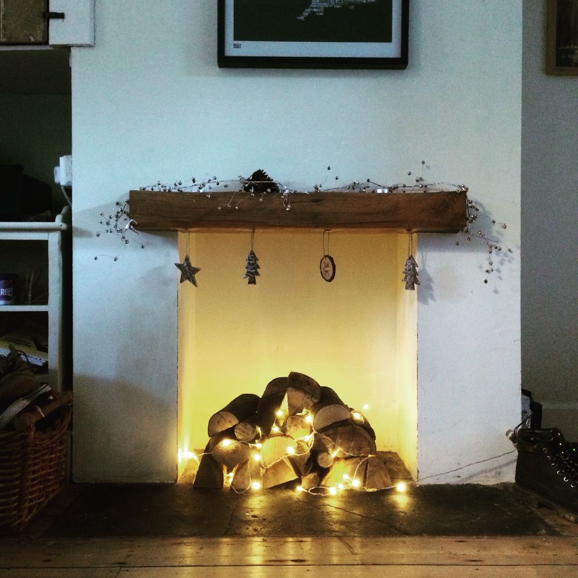 Christmas fireplace logs and fairy lights