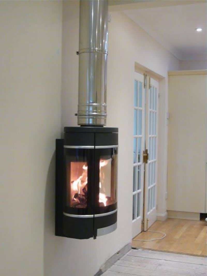 the scan 58 is a modern wood burner which can be wall hung seen rh pinterest com