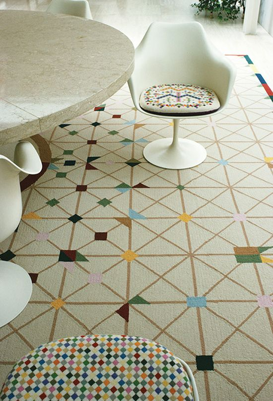 Alexander Girard's custom rug for the Miller House. Saarinen marble topped tulip table and chairs, too.