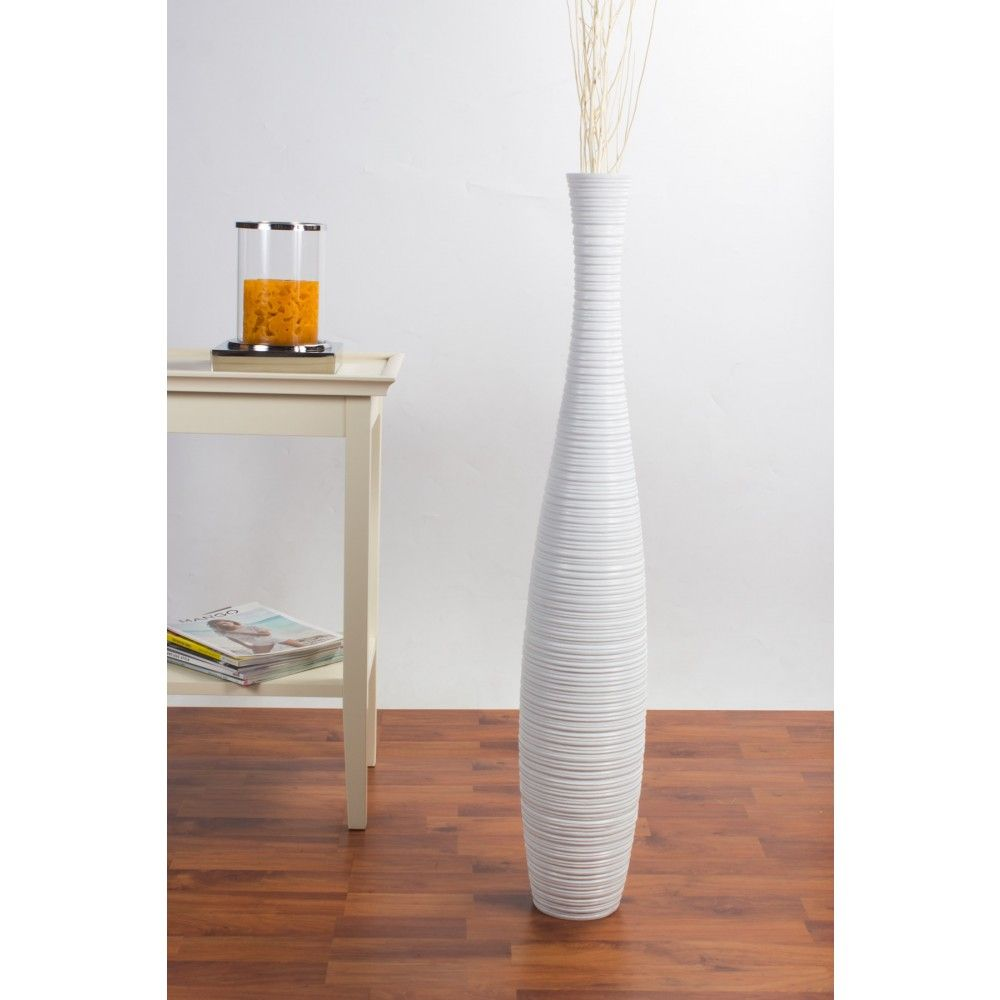 Modern Interior Design With Slim Tall White Floor Vase High Quality Ceramic Construction High Quality Ceramic Construction And Laminate Wood Floor Floor Vase Decor Modern Interior Design Wood Laminate Flooring