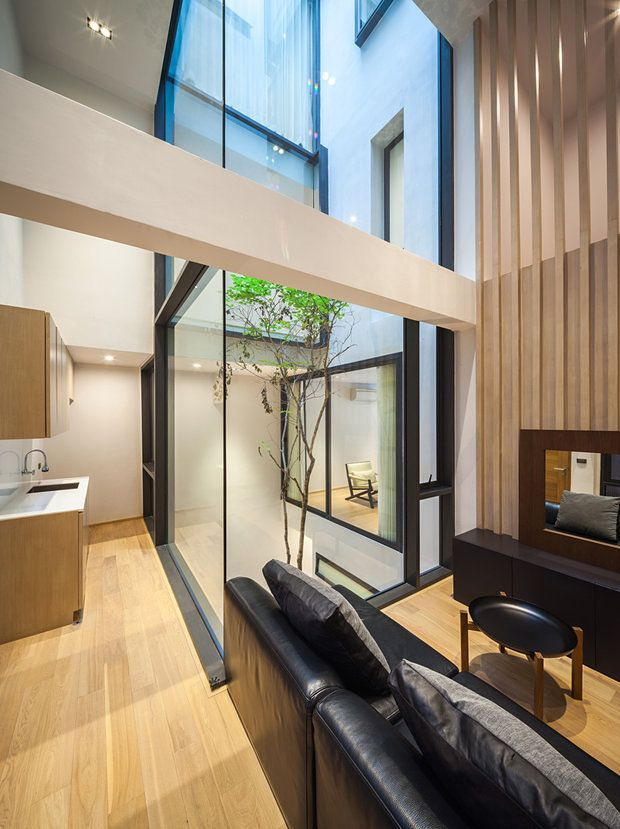 Ailing Office Building Becomes Modern Residence in