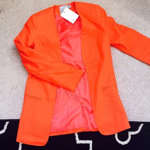 """BRAND NEW ASOS fiery orange blazer ✔️130+ items sold with a 5.00/5 star rating  10 % seller ❎ Trades or Paypal please   Pet & smoke free home All items shipped carefully w/freebies  Tuxedo style blazer. UK6, US size 2. I would keep it because it's amazing but I already have 2 orange Blazers. This is linen and viscose.  Very unique and stunning. Back slit at bottom hem. Style creates a slimming effect. Total length approx 26.5"""". ///top 10% seller///average rating: 5.00 stars.Open to…"""