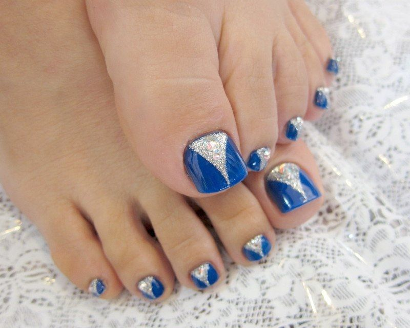 Look At This Picture In Which A Two Tone Toe Nail Art Is Created By Using Simple Blue Polish Silver Glitter