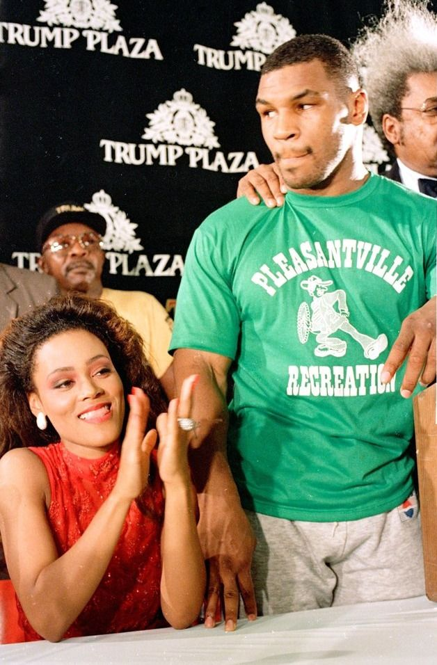 Mike Tyson and wife Robin Givens at a press conference before his title fight against Michael Spinks