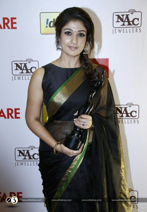 10676049a2b82 Nayanthara s sleeveless boatneck blouse with her elegant black cotton saree.  Simplicity never goes out of fashion!