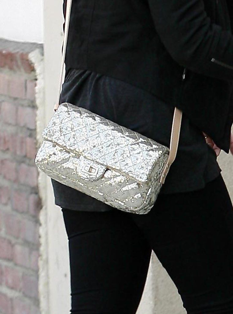 Kelly Osbourne showed off her metallic shoulder bag while hitting the streets of LA with her boyfriend Luke Worrall.
