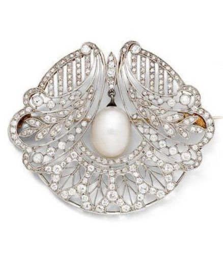 An Edwardian pearl and diamond brooch, circa 1910. Of openwork floral design…