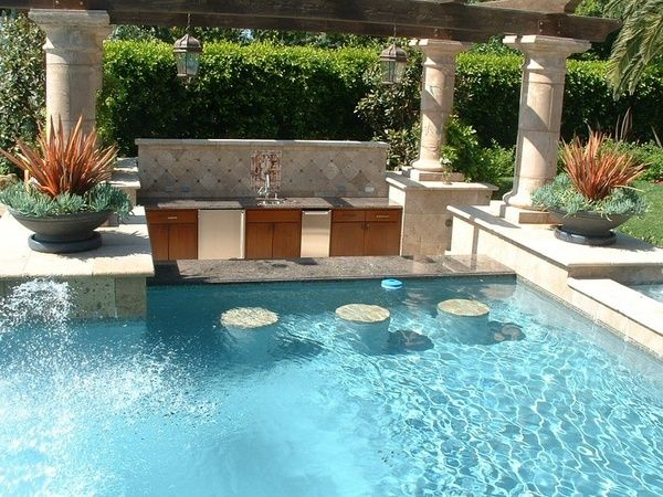 Swim Up Granite Top Counter Bar With In Pool Stools And A Sunken Bar Serving Area With