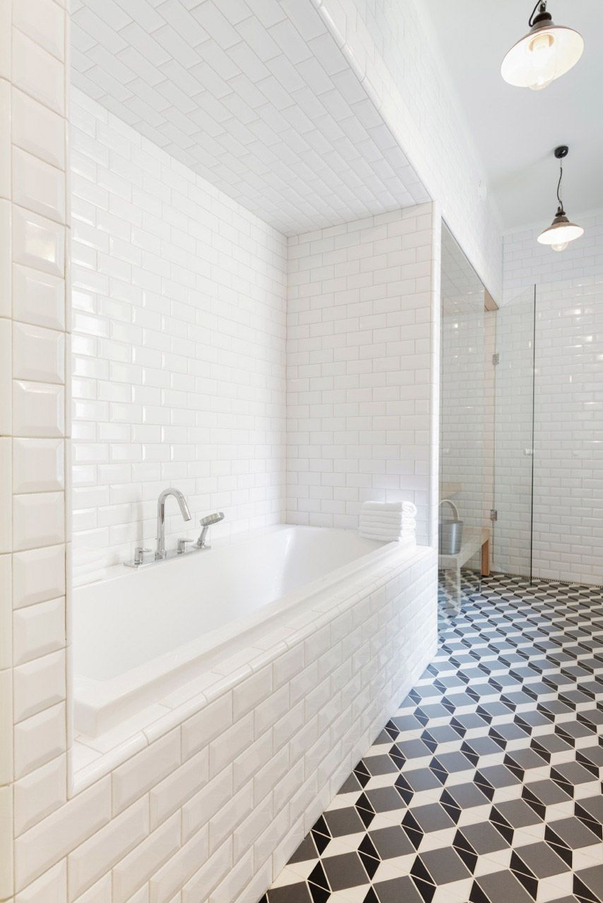 Beveled subway tile + graphic floor make a bath oozing with ...