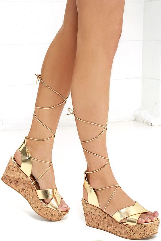 c1f48f206fb7 Longing for the perfect pair of sandals for the season  Say hello to the  Lovely Luster Gold Lace-Up Platform Wedges! Metallic gold vegan leather  crosses ...