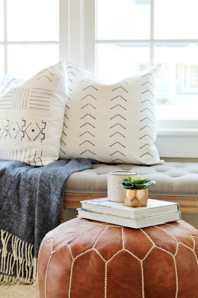 living room poufs%0A mud cloth pillows and leather pouf