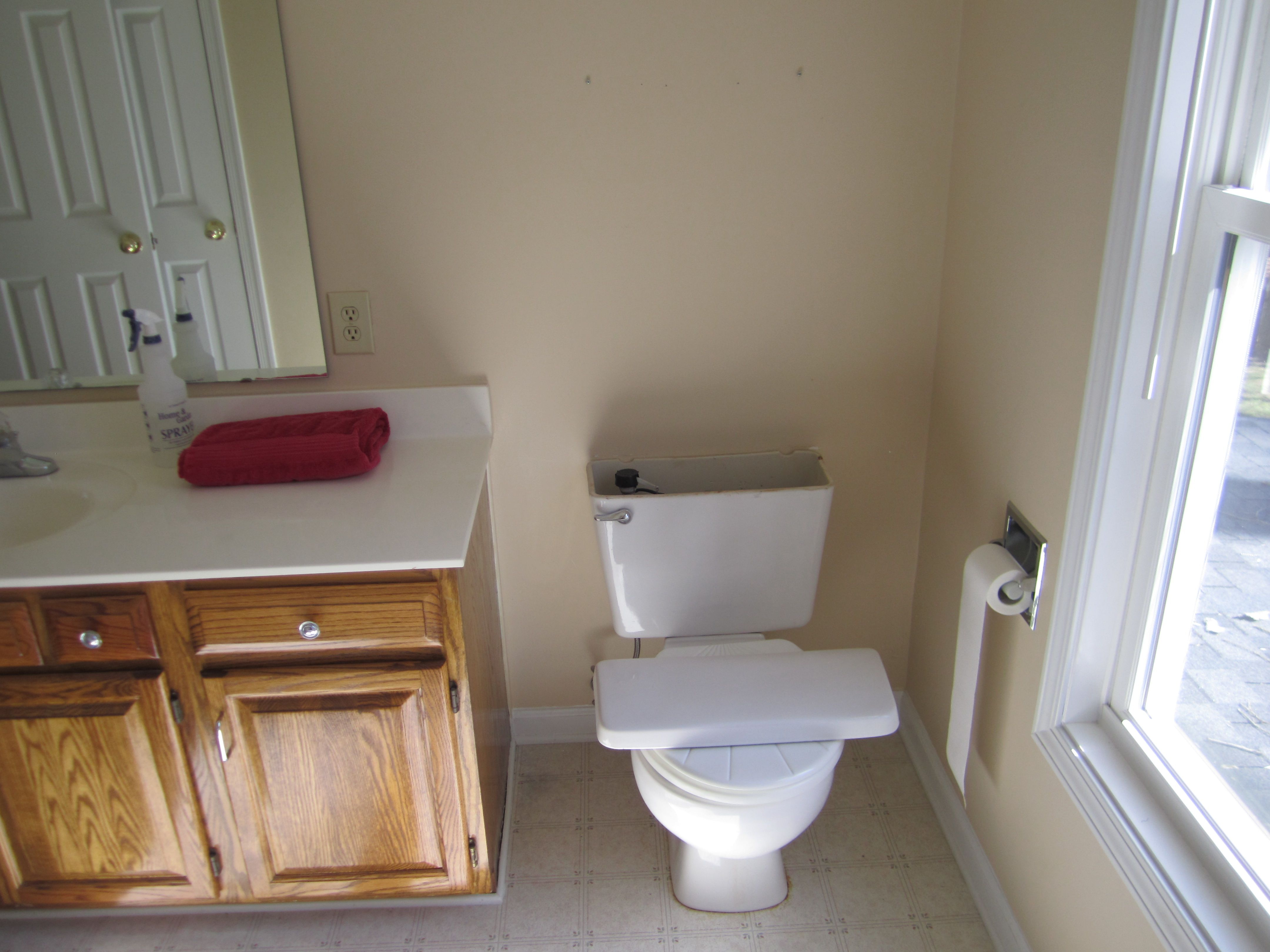 Upstairs Bath (before reno) Photo 4 (the toilet being broken was the ...