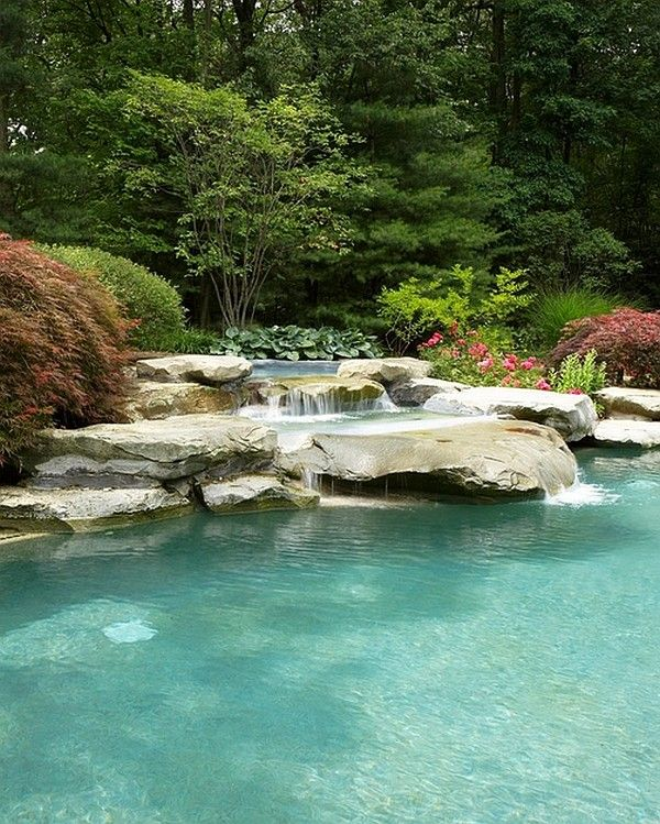 Tranquil Waterfall Pool Surrounded By Ample Natural Goodness Decoist Pool Waterfall Natural Pool Swimming Pool Designs