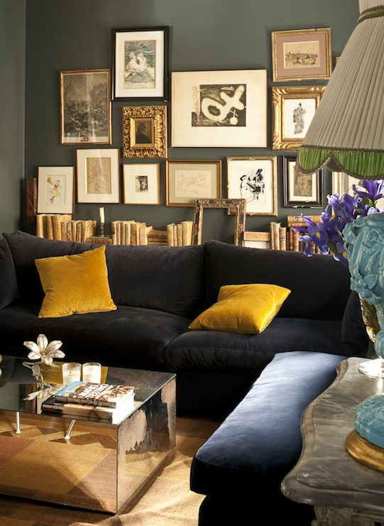 Fabulous Living Room Features Dark Gray Walls Which Highlight An Art Gallery Over Vintage Books Situated Atop A Narrow Sofa Table Lines The Back Of