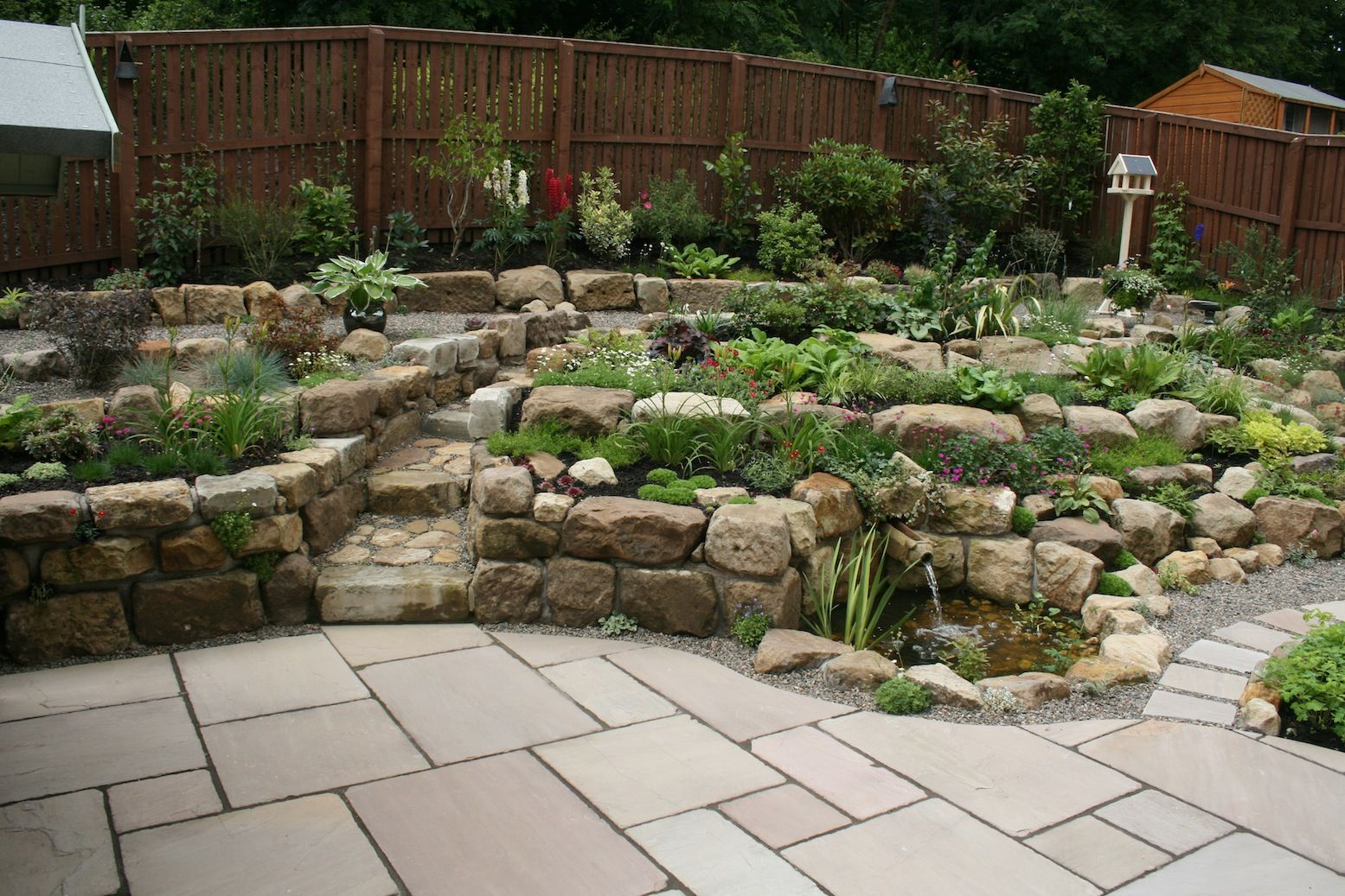 Rockery Constructed Using Reclaimed Natural Sandstone With Patio Pond Rock Garden Design Rockery Garden Lawn And Landscape
