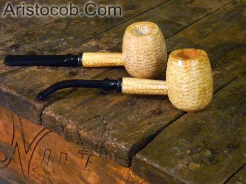 """This pipe is called the """"Diplomat Apple"""". There are actually a couple shaped bowls in the Diplomat line, but all feature a cob that is roughly the same size and a chamber that is roughly the same capacity.  This is the classic polished bowl, which is to say that it is covered with a layer of plaster of Paris which is then sanded smooth before being finished with a clear top coat.  This is one of my personal favorites.  Available at www.Aristocob.com"""