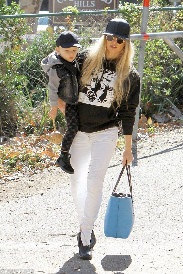 bd18cea86 Fergie and cute son Axl wear matching baseball caps to the park ...