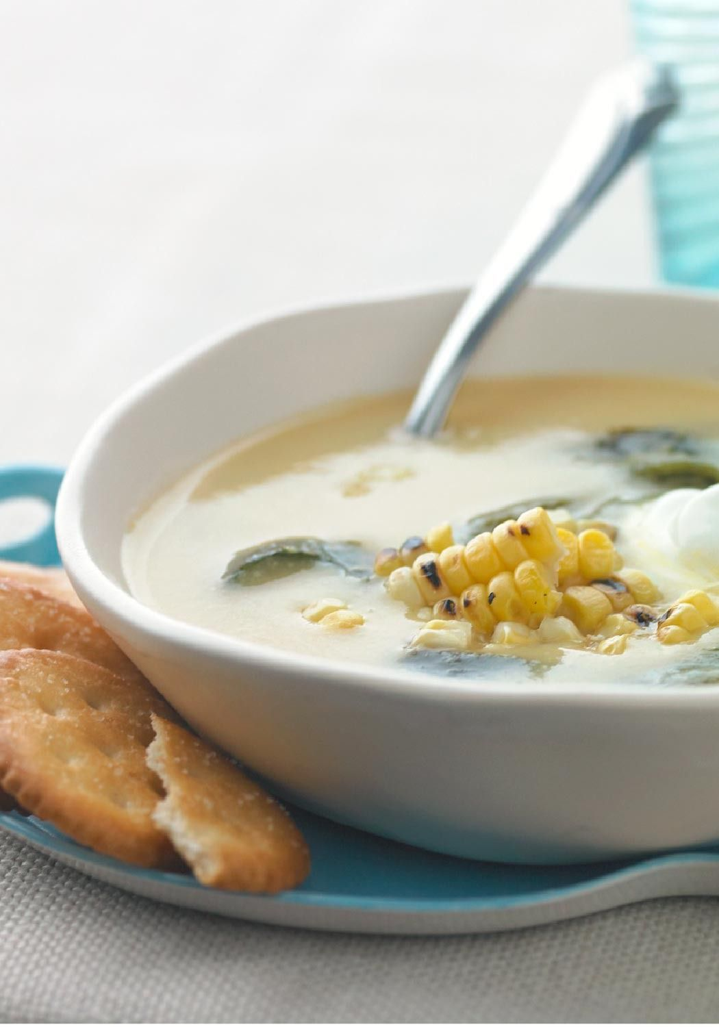 Roasted Corn & Poblano Soup -- Thick and chunky with red potatoes, poblano chile strips and corn fresh off the cob, this easy soup recipe will warm you up on even the coldest fall evenings.