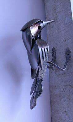 Stainless Steel Bird made from flatware and scrap metal.