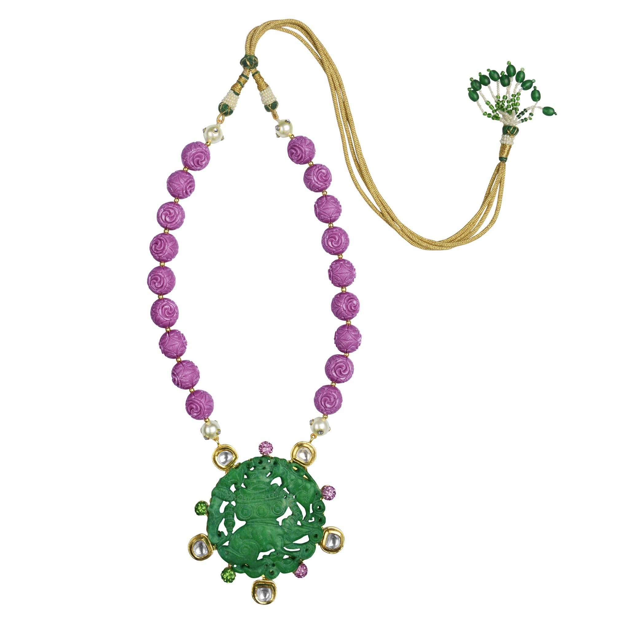 Intricately carved green and purple onyx stones strung together with