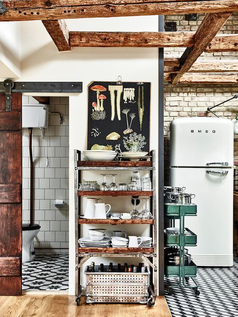 Love that you can see the Subway tile from the greater space! That Smeg refrigerator and wooden beams.