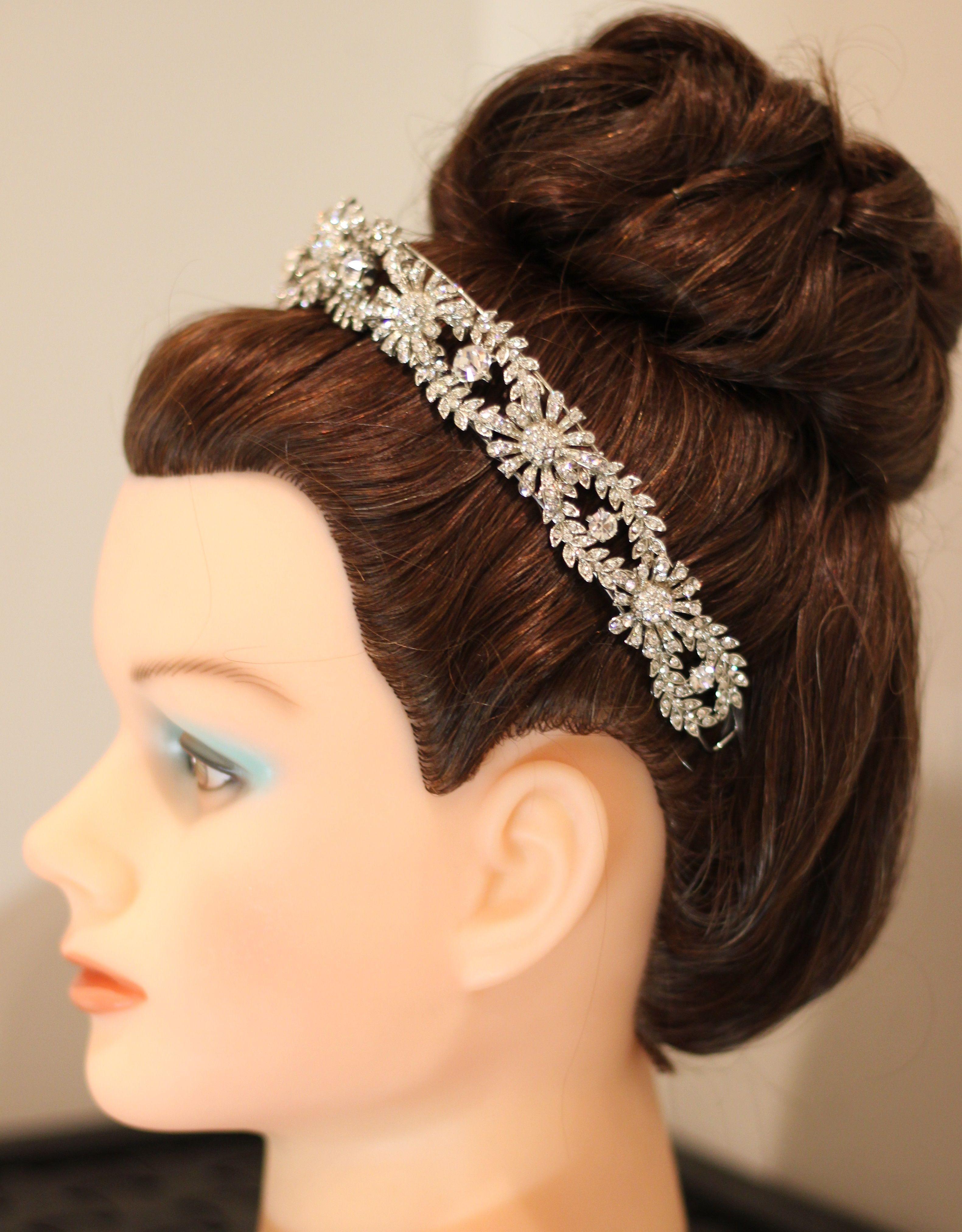 high textured bun updo with tiara | high up textured bun