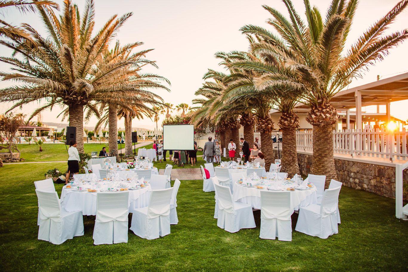 View of palm garden area of seaside wedding location in Crete. www ...