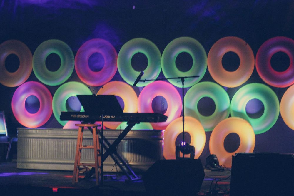 Neon inner tubes from Amazon: can be used as stage design or funky wall decor for venue