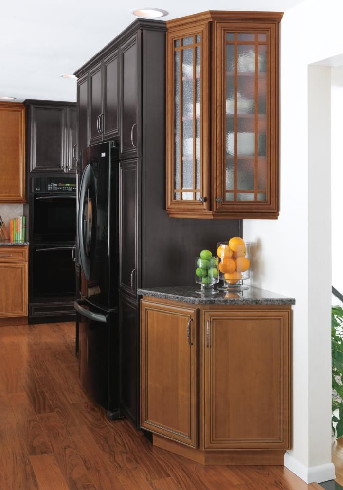 These Homecrest Madison cabinets offer extra storage for this homeowner. The deep drawers and tall wall cabinets ensure there is enough room for cookware and serving pieces in this renovated kitchen.