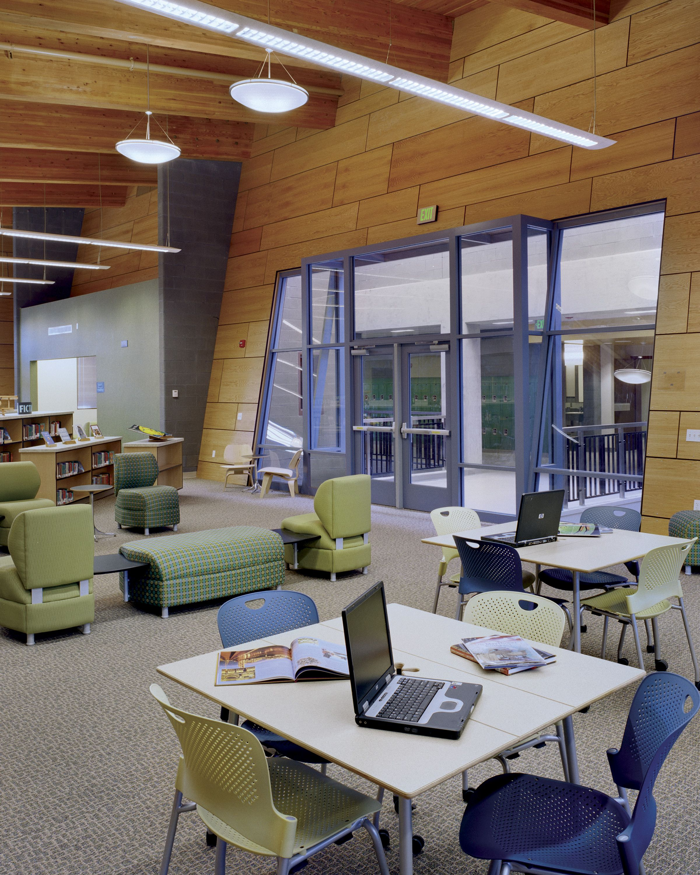 Caper Chairs and Intersect Tables Library Setting