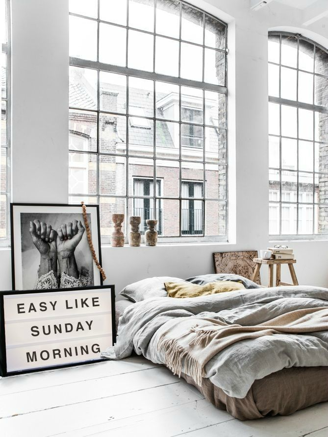 Chic loft bedroom with minimalistic industrial decor