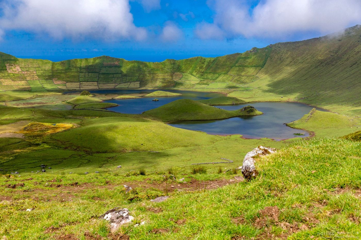 """Crater at Corvo - A dream to be here surrounded by green grass, water and kissed by the sun.  Found paradise this year on my trip to Corvo/Azores. Thanks Carlos Mendes!  https://500px.com/carlosmendes4  More pictures on my facebook Account: <a href=""""http://www.facebook.com/norlies1"""">Facebook</a> ."""