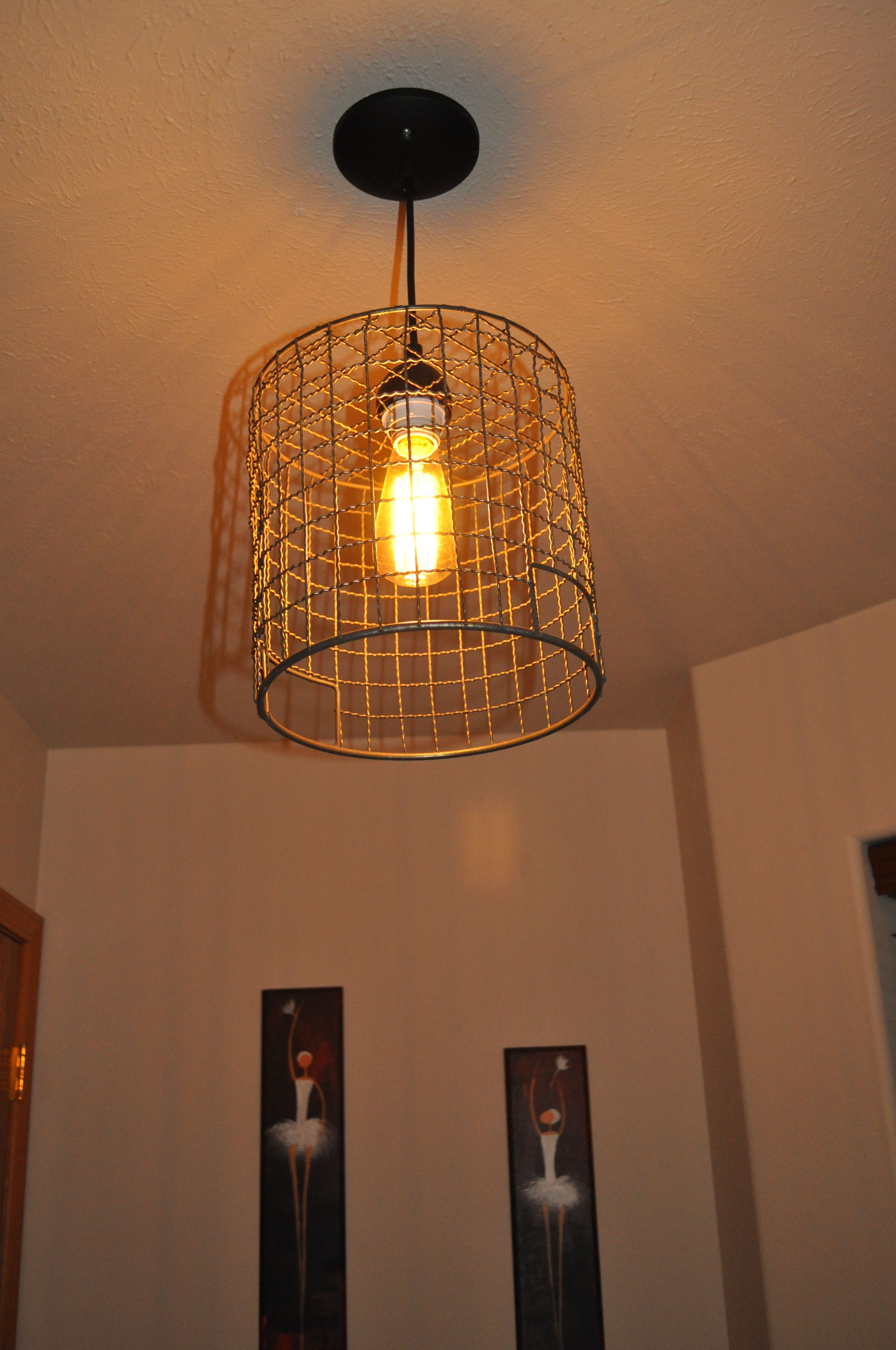 light fixture made from wire basket and vintage light bulb our rh pinterest com