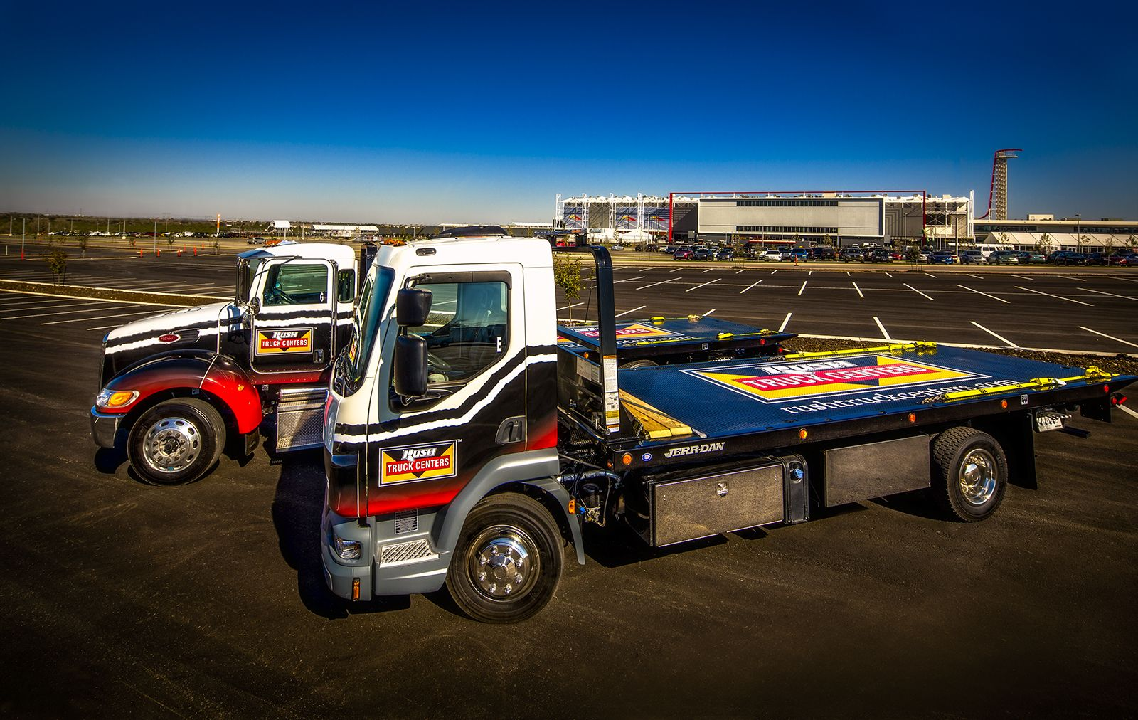 Vehicle wrap design rush truck centers tow truck wraps done for grand opening of the