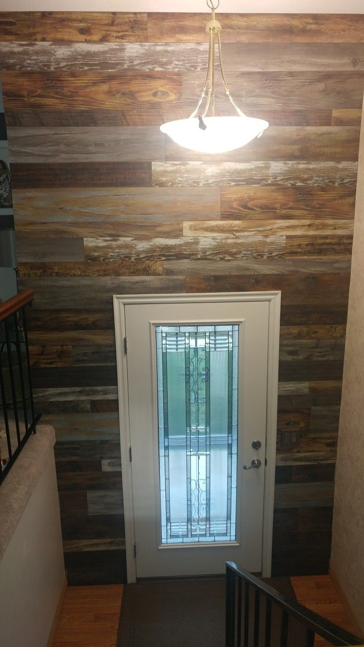 Living Room Walls Wood Panels: DIY Wood Paneled Wall. We Used Pergo Flooring. Love It