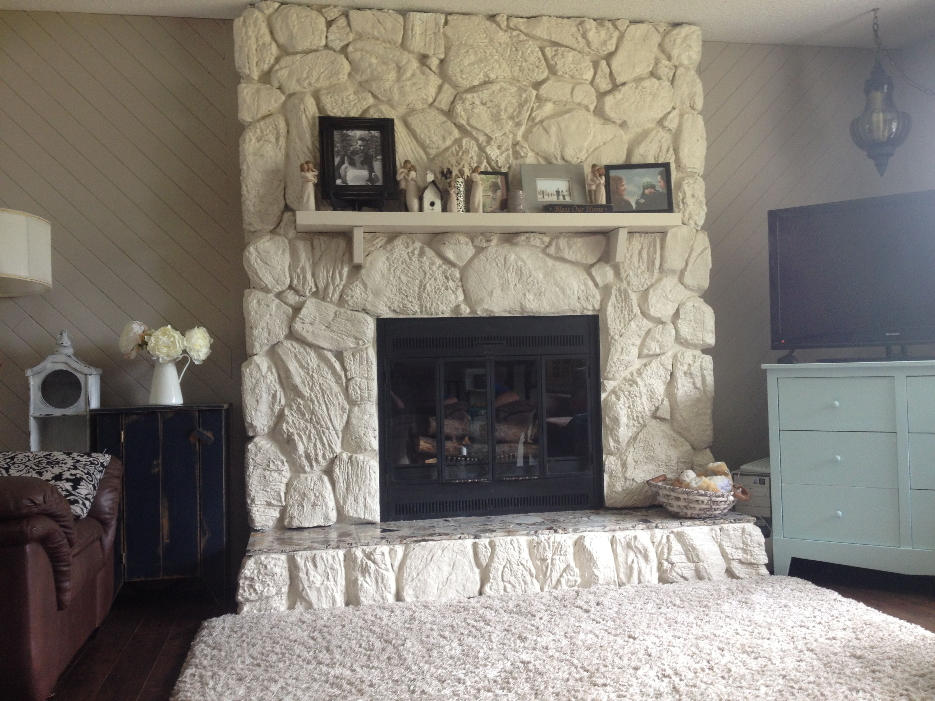 Painted rock fireplace, huge improvement! Makes the room feel so ...