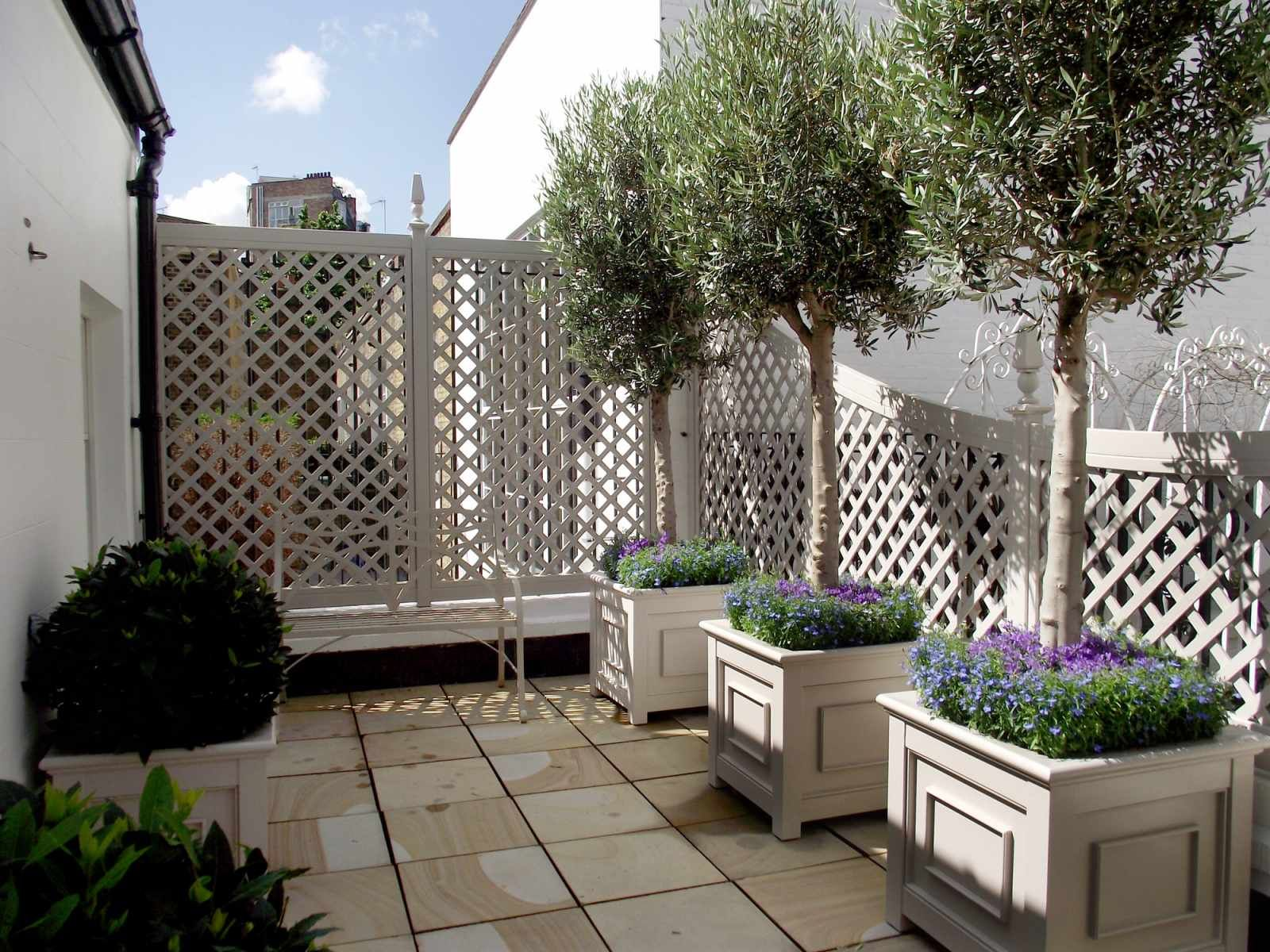 Photo of Painted bespoke planters and trellis