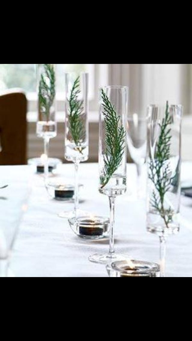 winter wonderland wedding table ideas%0A I think I would prefer cylindars to champagne flutes  as to not confuse as  a drink    Table decoration  Pine herbs in a champagne flute with some   snow    and