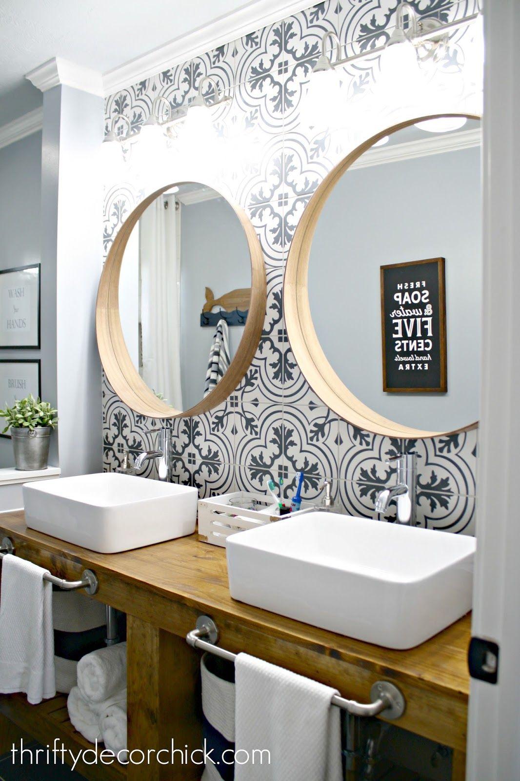 Bathroom makeover with wood vanity vessel sinks