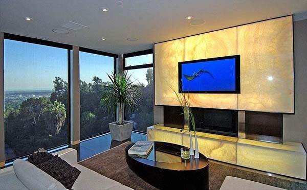 backlit onyx panels surrounding a wall mounted tv visit rh pinterest com