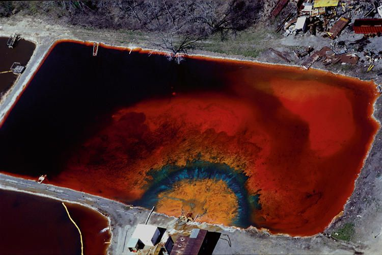 <p>A waste pit near Detroit auto factories</p>