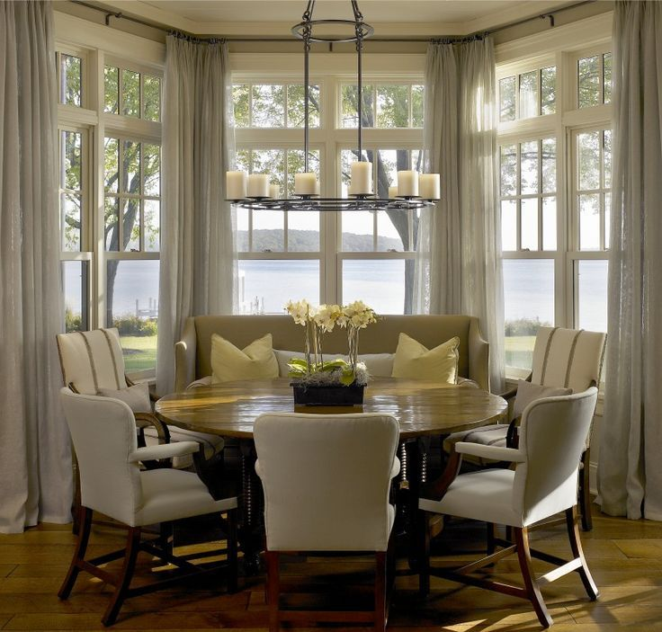 living room window valance ideas%0A     window with an amazing water view  Wonderful design by Hickman and  Associates  round dining tables  monochromatic color scheme  casual  dining room