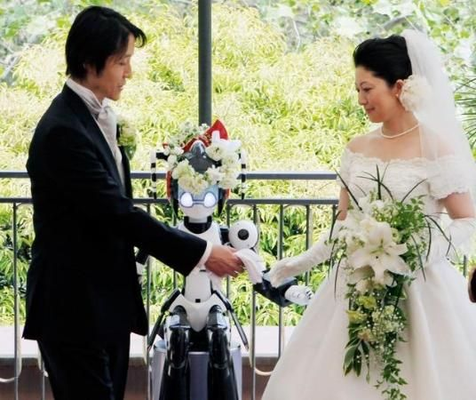 I do.... I-Fairy, a four-foot tall seated robot, directs a wedding ceremony in Tokyo.