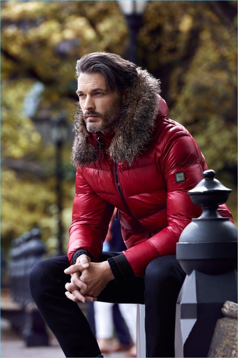 American model Ben Hill wears a red down jacket for Lufian's fall-winter 2017 campaign.