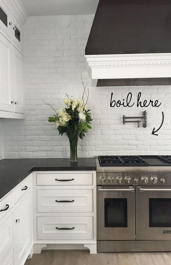 White Painted Brick Backsplash against Honed Black