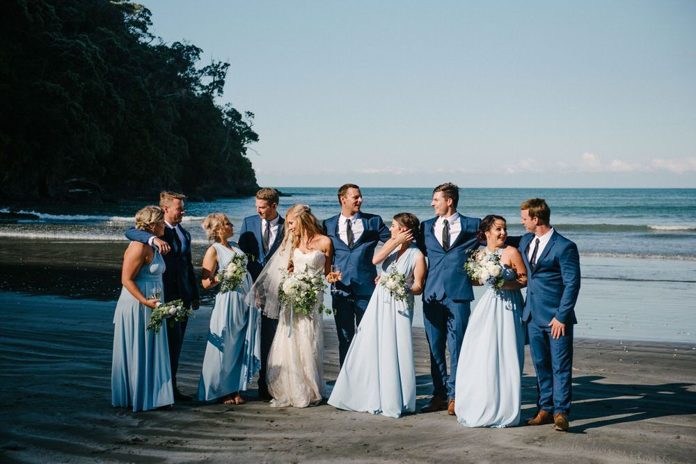 Beach wedding party in shades of blue