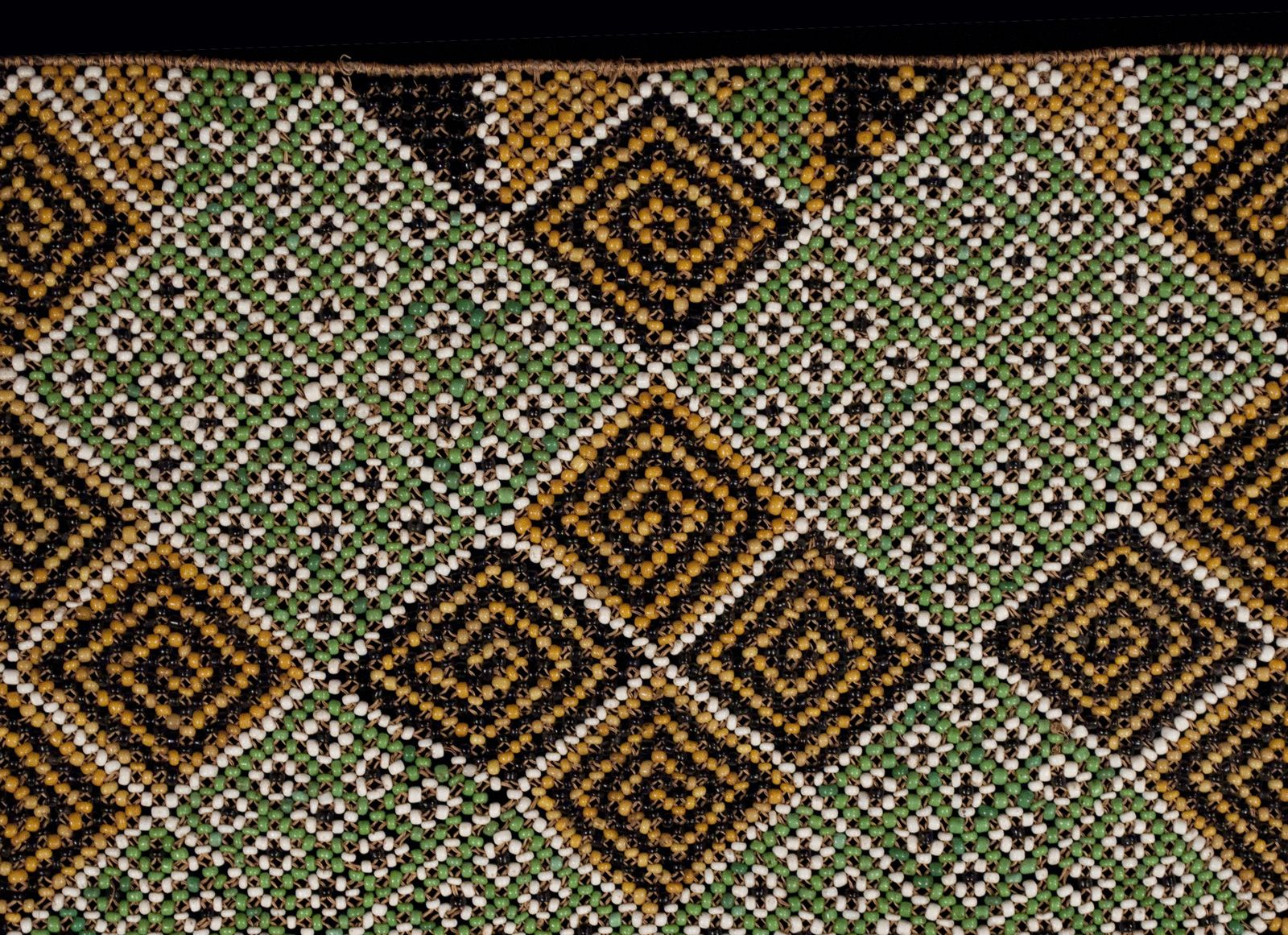 """Serue, woman's ceremonial apron  Geelvink Bay, West Papua New Guinea  Glass beads, fiber, trade cloth  Beaded area is 18"""" (45.5 cm) wide by 14.5"""" (37 cm) high  Early to mid-20th century"""